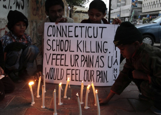Pakistani children light candles to pay tribute to Sandy Hook Elementary School shooting victims.
